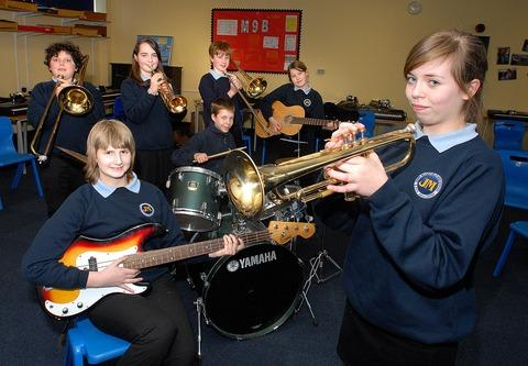 IN TUNE: Pictured from left, Elly Merryman, 12, Joe Bloomer, 14, Molly McCabe, 12, Aaron Clayton, 12, Jamie Hiley, 12, Eleanor Crowson-Jeffrey, 13, and Elen Clarke, 13. 1113270401.