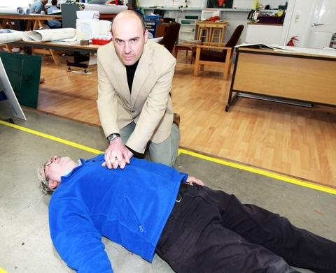Tim Gluyas takes on the role of Vinnie Jones while sign maker Shaun Baldwin plays the part of the casualty to promote a Hereford HeartStart course in Leominster.