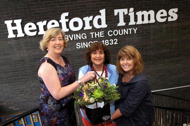 Hereford Times editor Fiona Phillips (left) and Heather Gorringe (right), from the Great British Florist, congratulate Rita Thirlwall on her hero award.