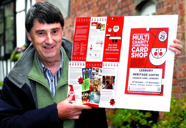 FOLLOW THE SANTA: Card shop manager Ian Cook hopes to help up to 24 charities when he opens his doors. 4213430301.