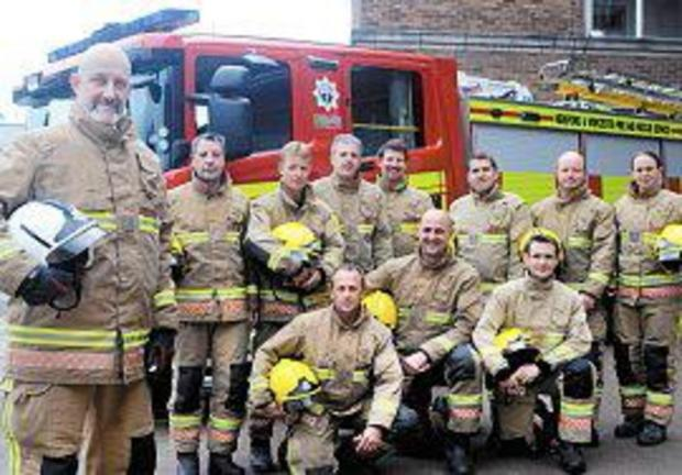 Wishing Boris Borkowski (far left) well are colleagues from red watch