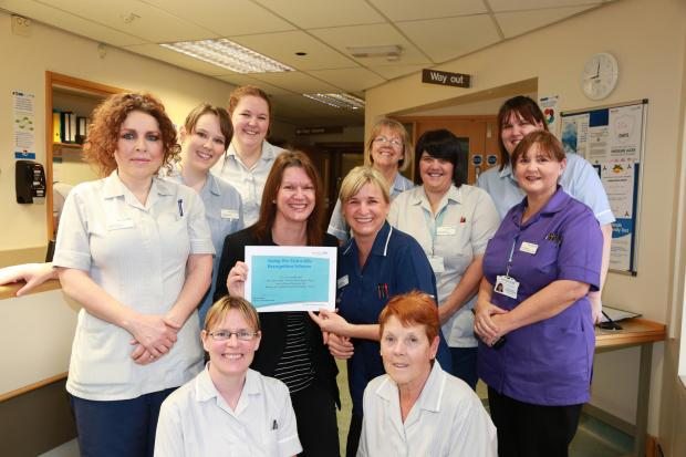 Leominster Community Hospital team receive their award from Michelle Clarke, director of nursing and quality. (2732379)