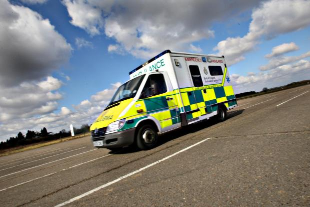 An ambulance was called to help a woman who was in collision with a car.