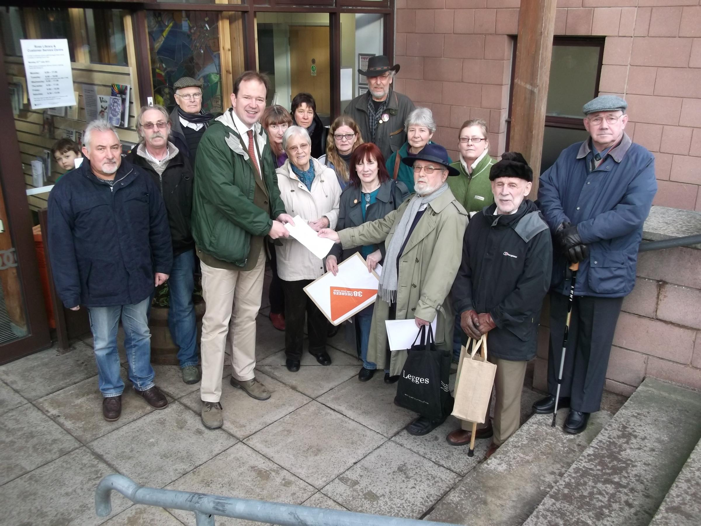 Hereford and South Herefordshire MP Jesse Norman is handed a gagging law petition outside Ross-on-Wye Library.
