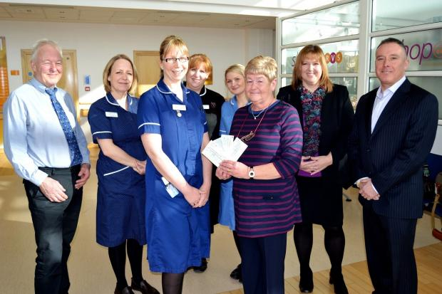 Linda Patrick presents her donation to Junior Ward Sister Kerry Burbidge wit