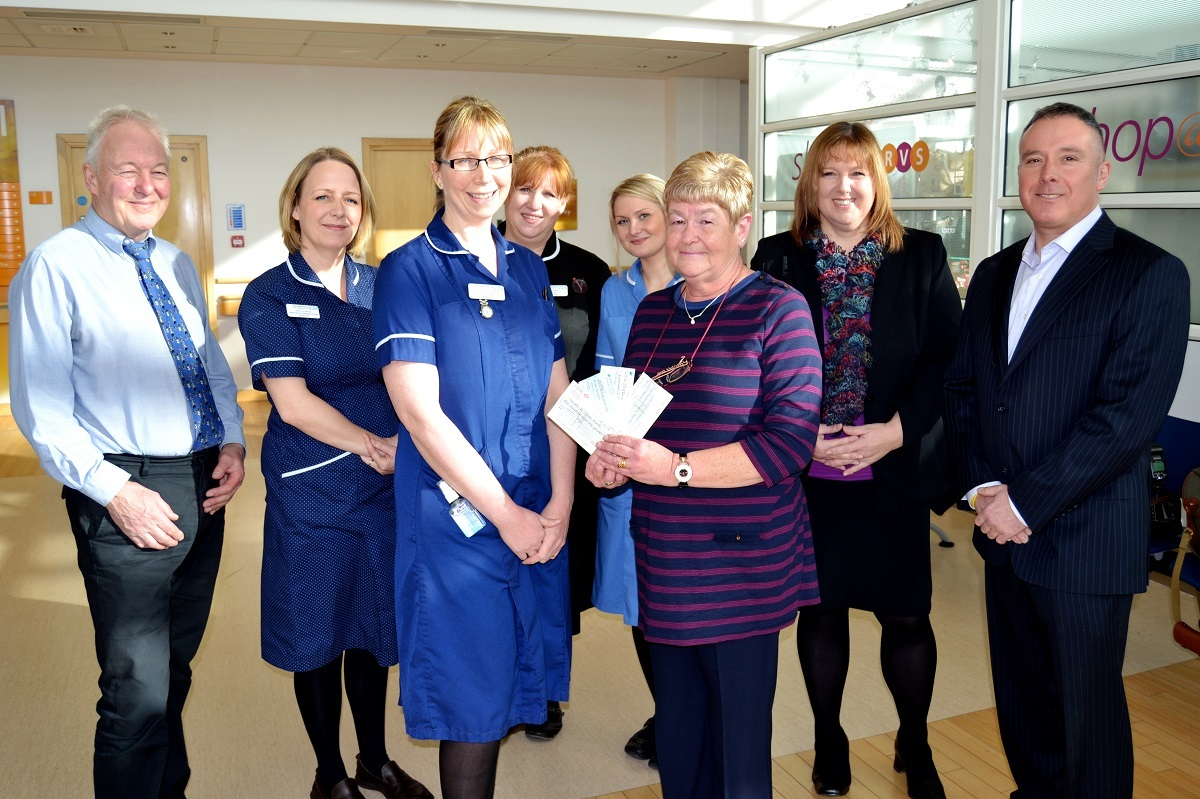Linda Patrick presents her donation to Junior Ward Sister Kerry Burbidge with consultant physician Dr Chris Pycock, specialist nurse Heidi Nunwick, matron Jane Rutter, Matron, staff nurse Rebecca Poile, along with Mr Patrick's daughter Lyn Goodwin a
