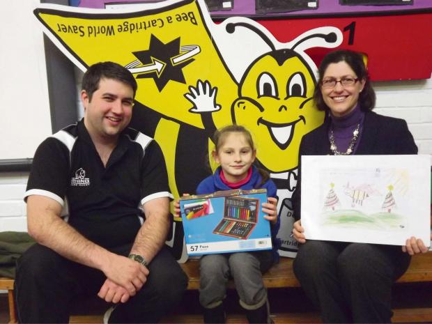 Ledbury Reporter: (l-r) Teacher Phil Greenow, winning pupil Ioana Partene and Alex Pattison-Appleton, director of Cartridge World, with the winning picture.