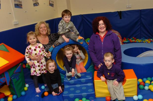 1412_5001 Outstanding OFSTED at Merry-Go-Round @ Riverside nursery. Manager Nicki Overs (left) & Asistant Manager Karen Robinson with children Milena Witek, Lilley Davies, Isabelle Stokell, Daniel Jones, Daisy Davies & Marshall Turner. (4695346)