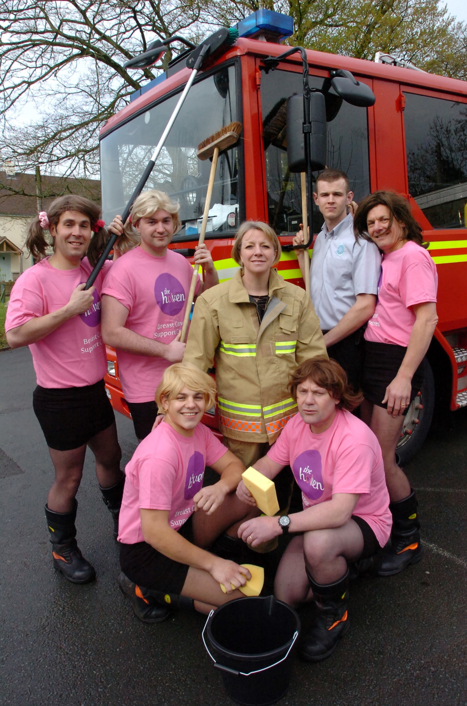 Firefighters swap hard hats for skirts and ribbons for charity