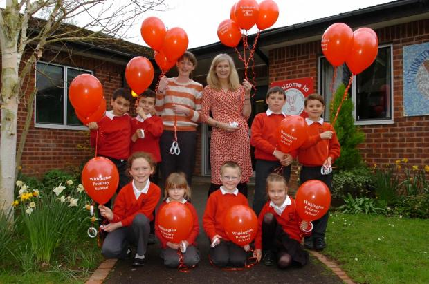 Ledbury Reporter: Withington Primary School pupils given balloons to celebrate a good Ofsted inspection.(back l-r), Abdul Quieshi, Zak Davies, Mrs Sarah Houchen, Mrs Sue Woodrow (Head of Learning), Jacob Camden Redding, Jack Pockett, (front), Sophie Wareham, Christine Bow,