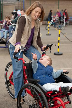 A mother and son try one of the adapted bikes for people with special needs. Photo by Ian Lloyd Photography.