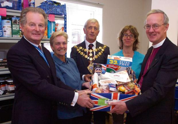 Ledbury Reporter: (l-r) Former Herefordshire High Sheriff Bob Tabor visiting the food bank last year with volunteer Carol Plant, Mayor of Hereford Phil Edwards, food bank administrator Alison Russell, and the very Rev Anthony Priddis.