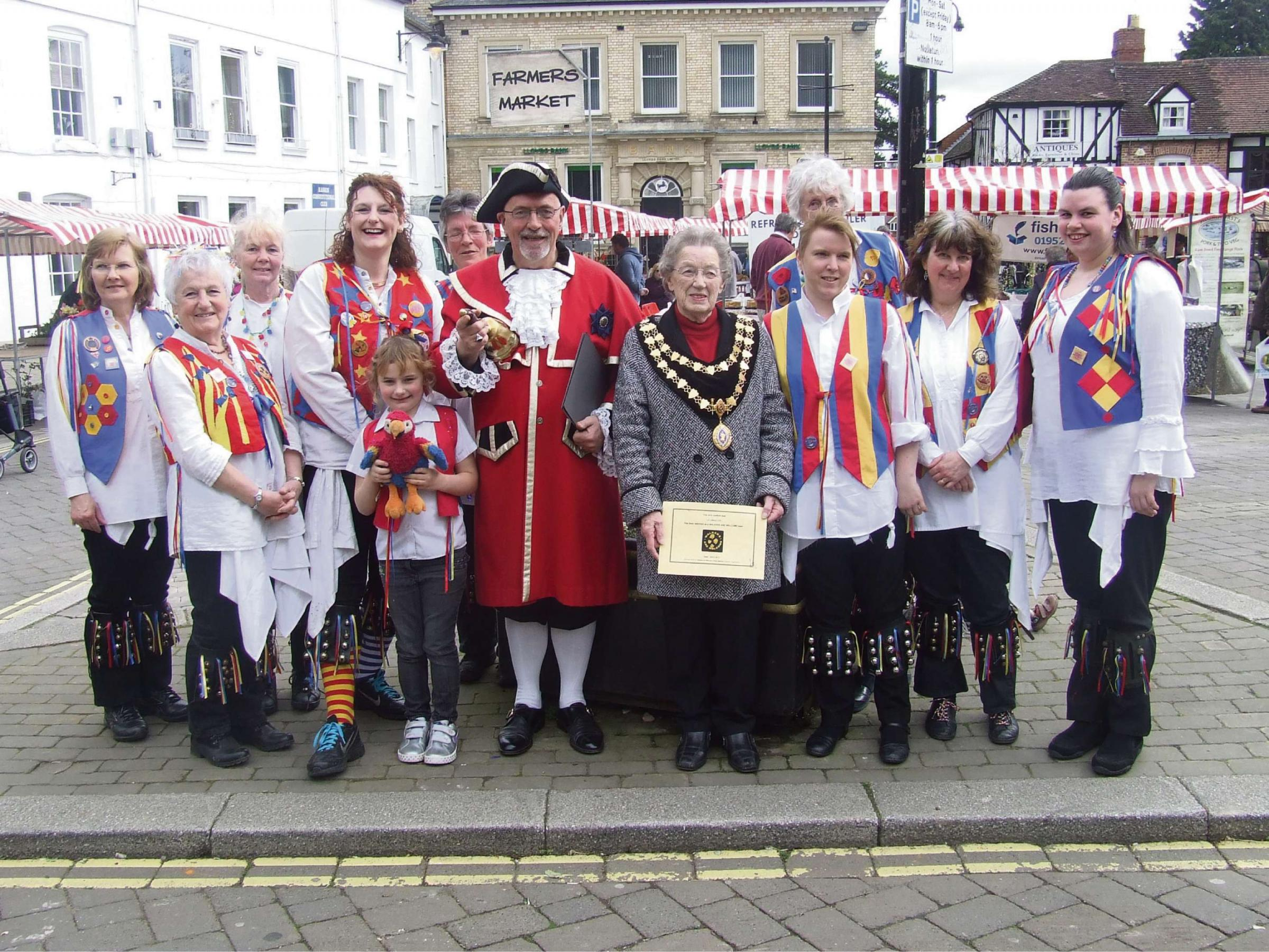 Leominster's mayor Mollie Cooke with the town crier and members of Jenny Pipes Morris.