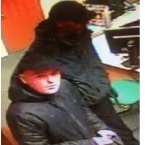 A CCTV image showing two men the police would like to speak to in connection with a burglary in Hereford.