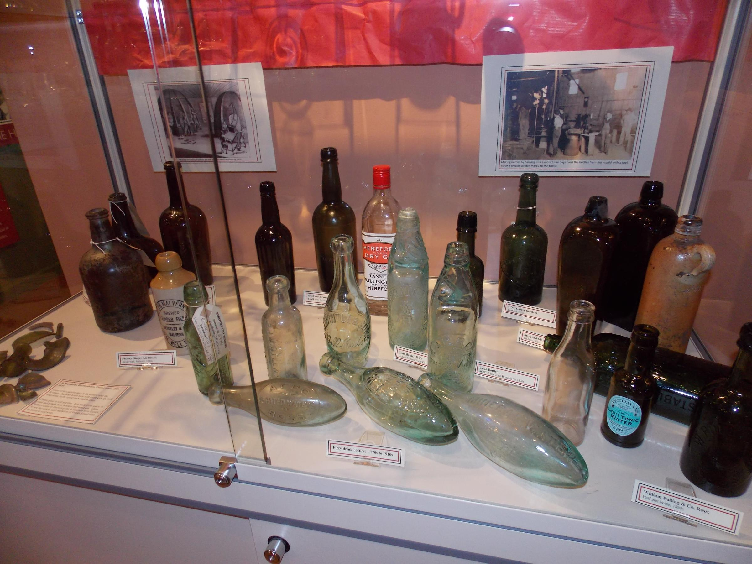 The bottles in their new home as part of an exhibition at the Hereford Cider Museum.