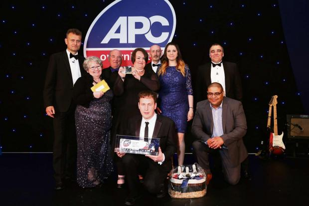 Ledbury Reporter: Staff at APC Hereford receive their award from celebrity host High Dennis.