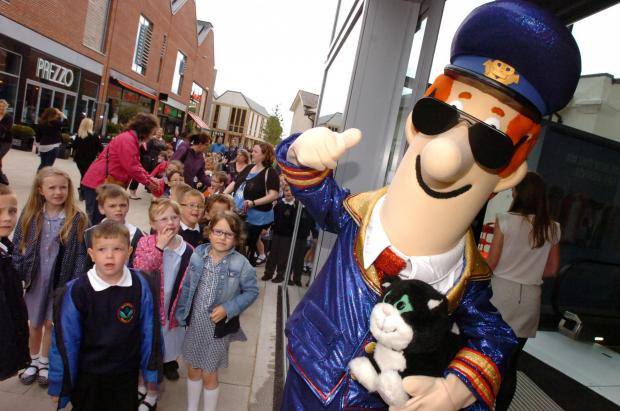Ledbury Reporter: Marlbrook Primary School children meet Postman Pat.