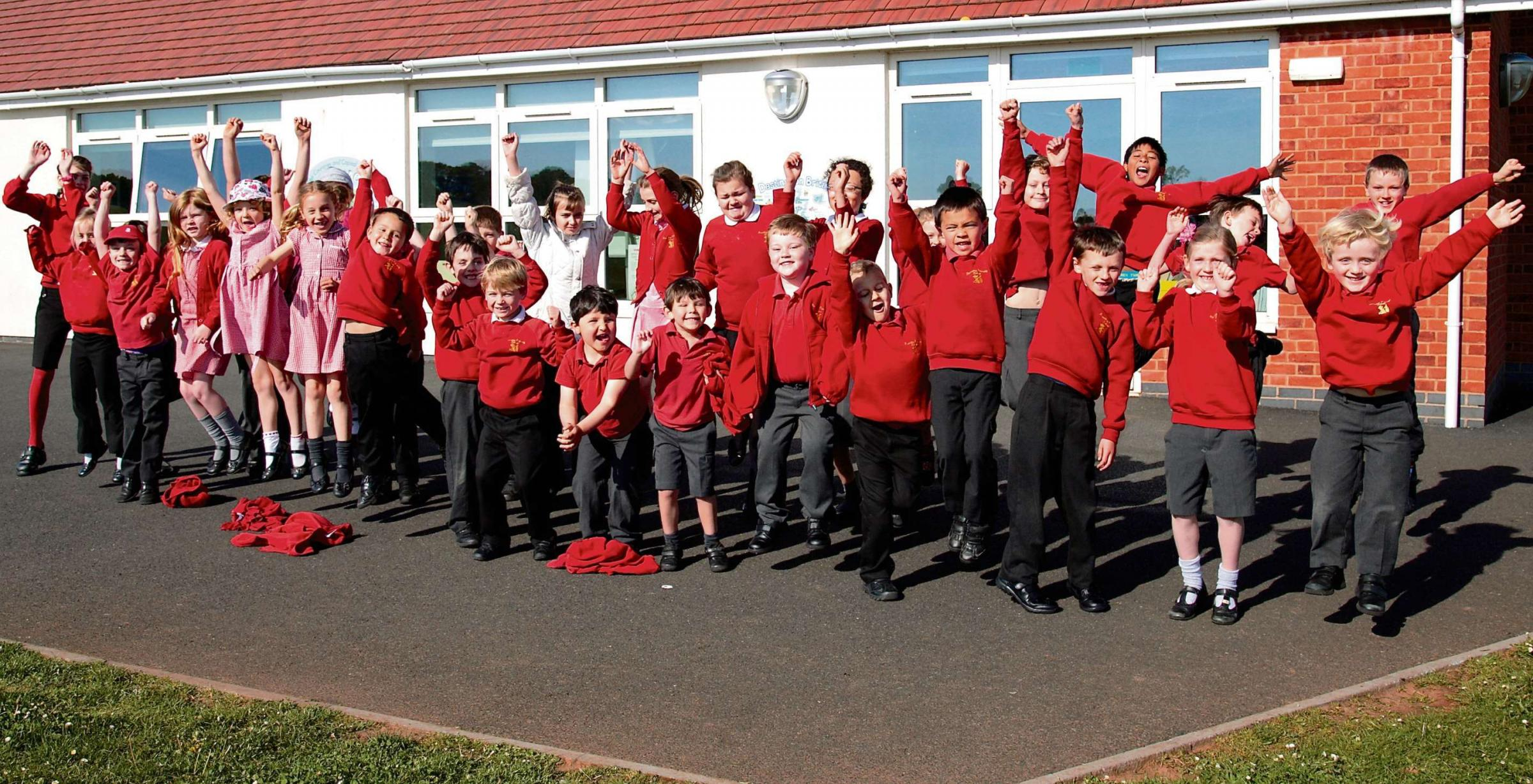 Hooray: Pupils at Pauntley CE Primary School celebrate their positive Ofsted report.