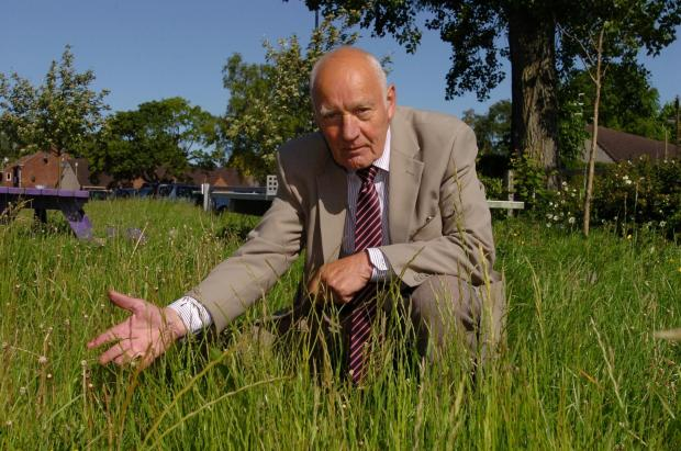 Leominster Councillor Peter McCaull, pictured in an outdoor play area donated by Cadbury's, is unhappy about how often the grass is being cut in Leominster. (6408586)