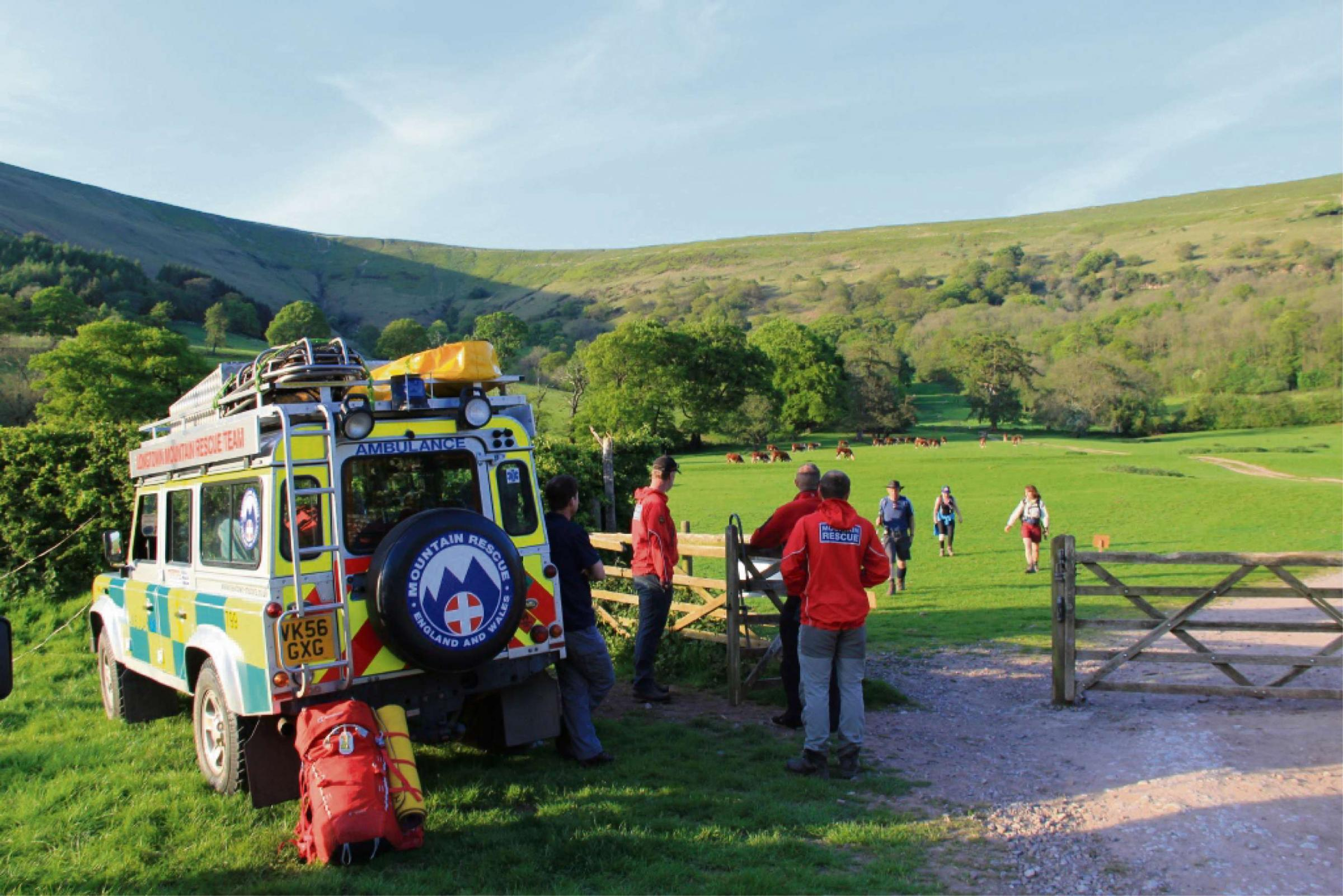 Hikers are watched into one of the checkpoints by Longtown Mountain Rescue Team volunteers.