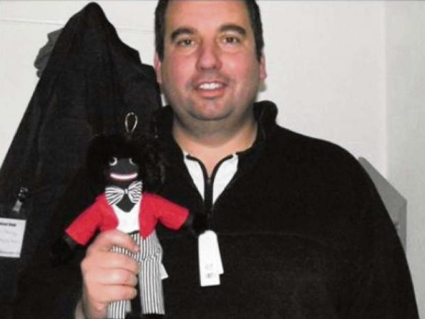"The picture from UKIP MEP Bill Etheridge's book, captioned ""The autor with his golliwog friend""."