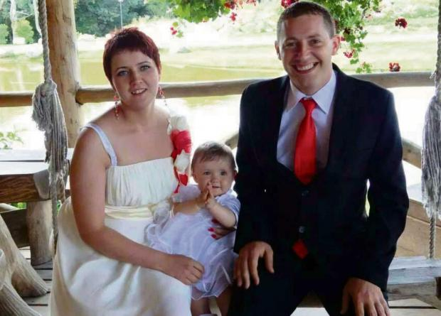Craig Hurcombe, pictured at the christening of his daughter, Jessica, alongside his fiancee Reda Butkute.