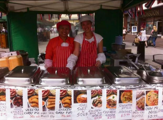 Ledbury Reporter: Pimploy Scott (left) at her popular stall Pim's Kitchen, in Hereford High Town.