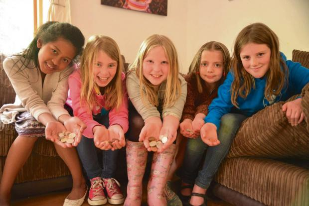 Ledbury Reporter: Launching the Under the Sofa fundraising campaign for St Michael's Hospice is (from left) Malisa Sithara, Emily Dereham, Freya Smart, Izzie Sherratt and Isabelle Sayce, who are all aged nine.