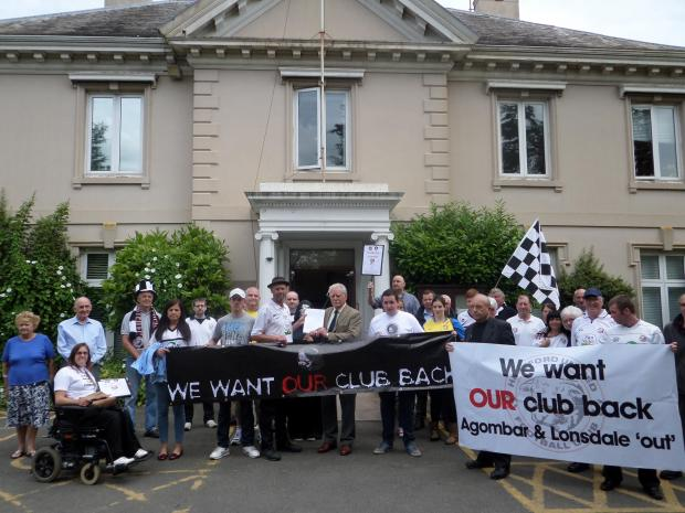 Ledbury Reporter: Hereford United supporters protest at Herefordshire Council's Brockington HQ