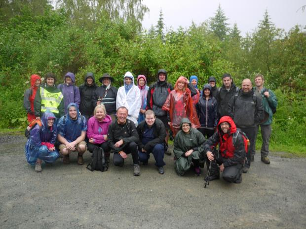 The team of 22 employees who completed a 30-mile charity walk.