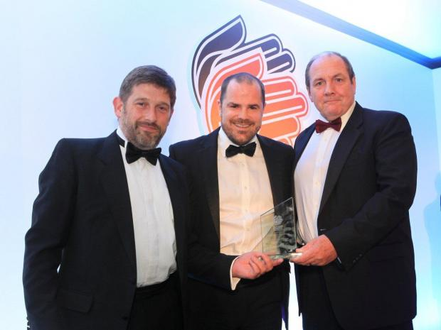 Ledbury Reporter: Ben Mannion from Hewett Recruitment with Adrian Pargeter and Spencer Murtagh from Kingspan. The Leominster-based firm picked up the award for manufacturer of the year.