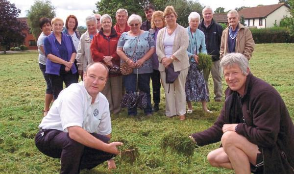 Ledbury Reporter: Sean Edwards and Jim Cotterell in front of other Kings Acre residents who are not happy with the lack of grass cutting.