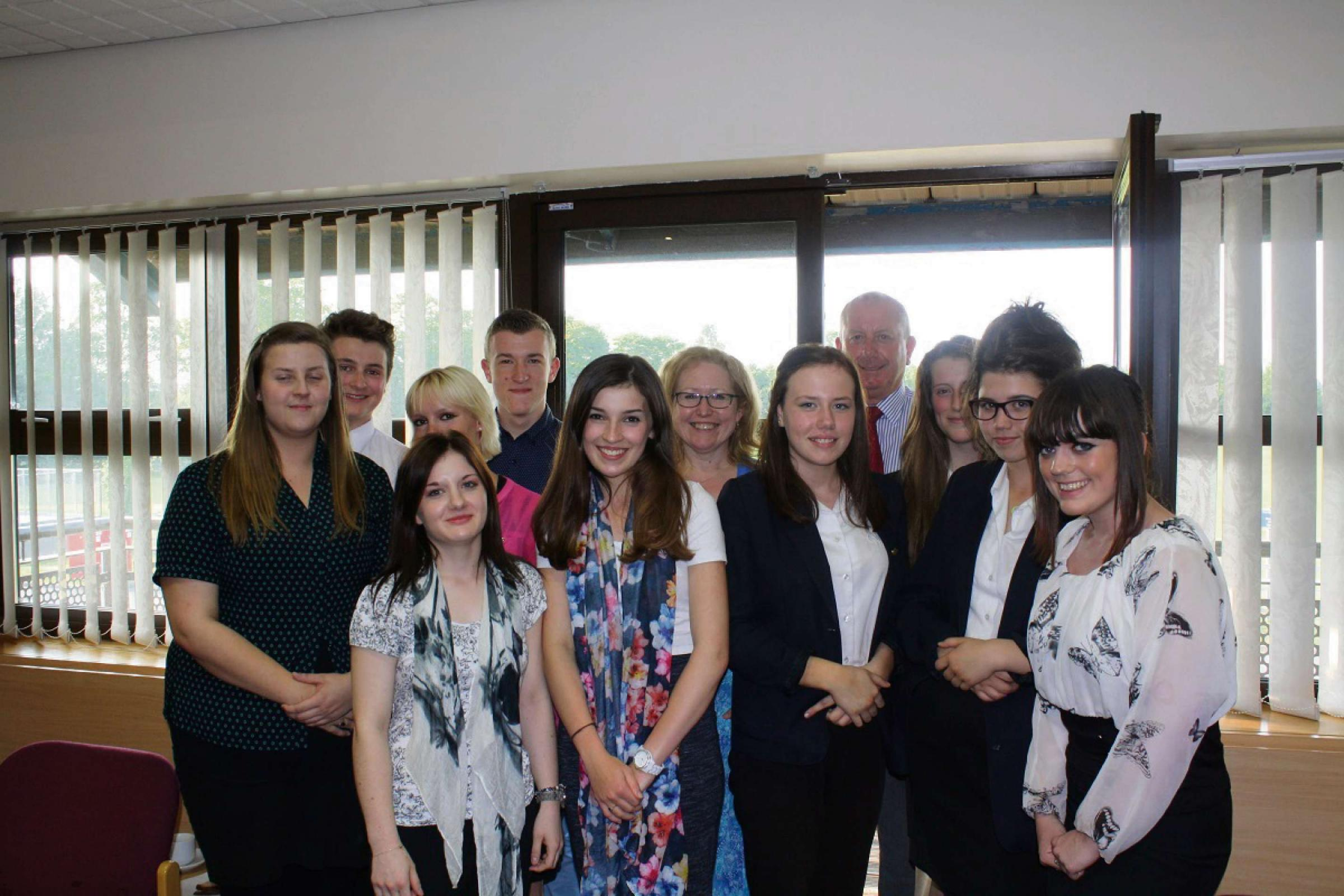 Members of Worcestershire Health and Care NHS Trust's youth board celebrate their first anniversary with chief executive Sarah Dugan and chairman Chris Burdon