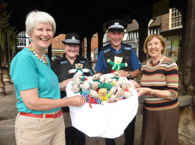 BEAR NECESSITIES: Sally Holliday and Peta McCauley hand over teddies to PC Johnson and PCSO Alexander