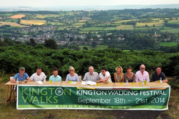 Kington Walking Festival  in a meeting on Bradnor Hill overlooking the town. From left are Vincent Playdon, Nick Eve, Geoff Cooper, chairman Barbara Barrett,  Bernard  Ray, Kay Birchley,  Cath Mahon, Helen Yeomans, Martin Peek and James Blair.  (Photo by