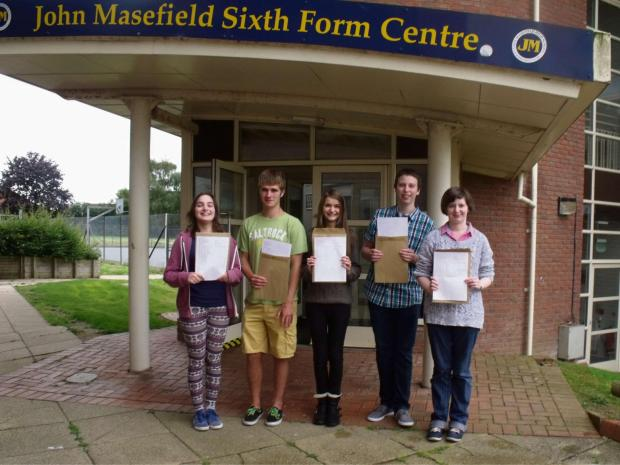 THE SMILES SAY IT ALL: John Masefield High School students celebrate A-level success on Thursday.