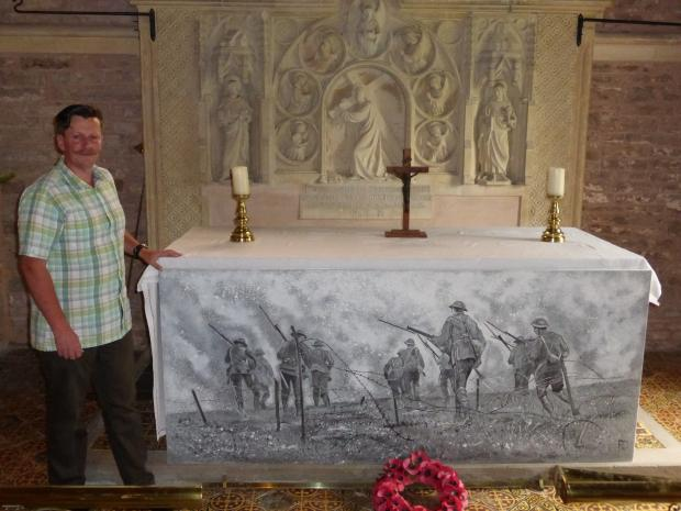 St Peter's Church warden, Robin Wilson with the altar frontal he has painted for the event. It shows a still from real footage of the Battle of the Somme.