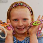 Ledbury Reporter: 9 year old Anne-Mae Potter sold loom band in aid of Acorn's Hospice. ENDS (9754930)
