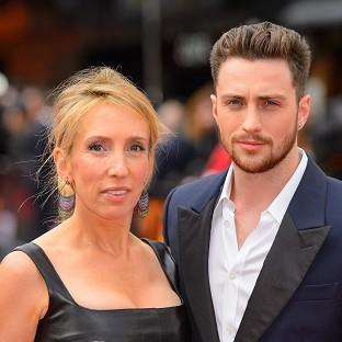 Sam Taylor-Johnson was left red-faced after police were called to her home when a passer-by spotted a machine gun on a desk inside the house