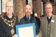 Len Tawn, Mayor of Hereford, Chris White, graphic artist, and Canon Chris Pullin with Hereford.Cathedral's facsimile of the Magna Carta. Photo: Mark Bowen