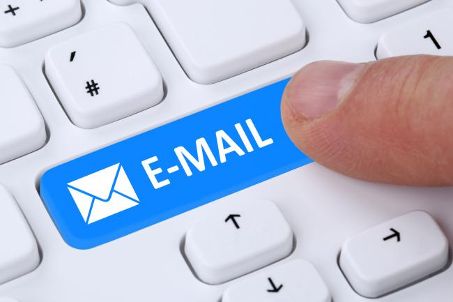 Sending E-Mail mail message by pushing button on computer keyboard with letter symbol (32610245)