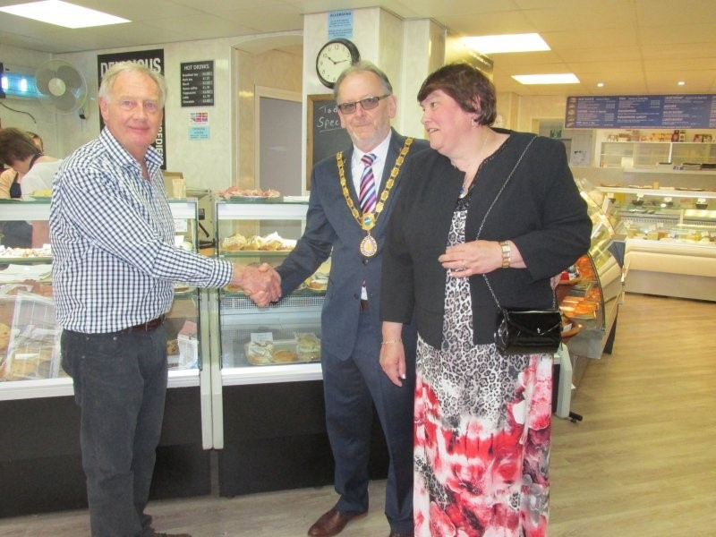 OPEN: Peter Maiden of Cooks Bakery welcomes Upton Mayor Cllr Tim Dance and Mayoress Sally Padfield to the shop's reopening. Picture by Jackie Surtees
