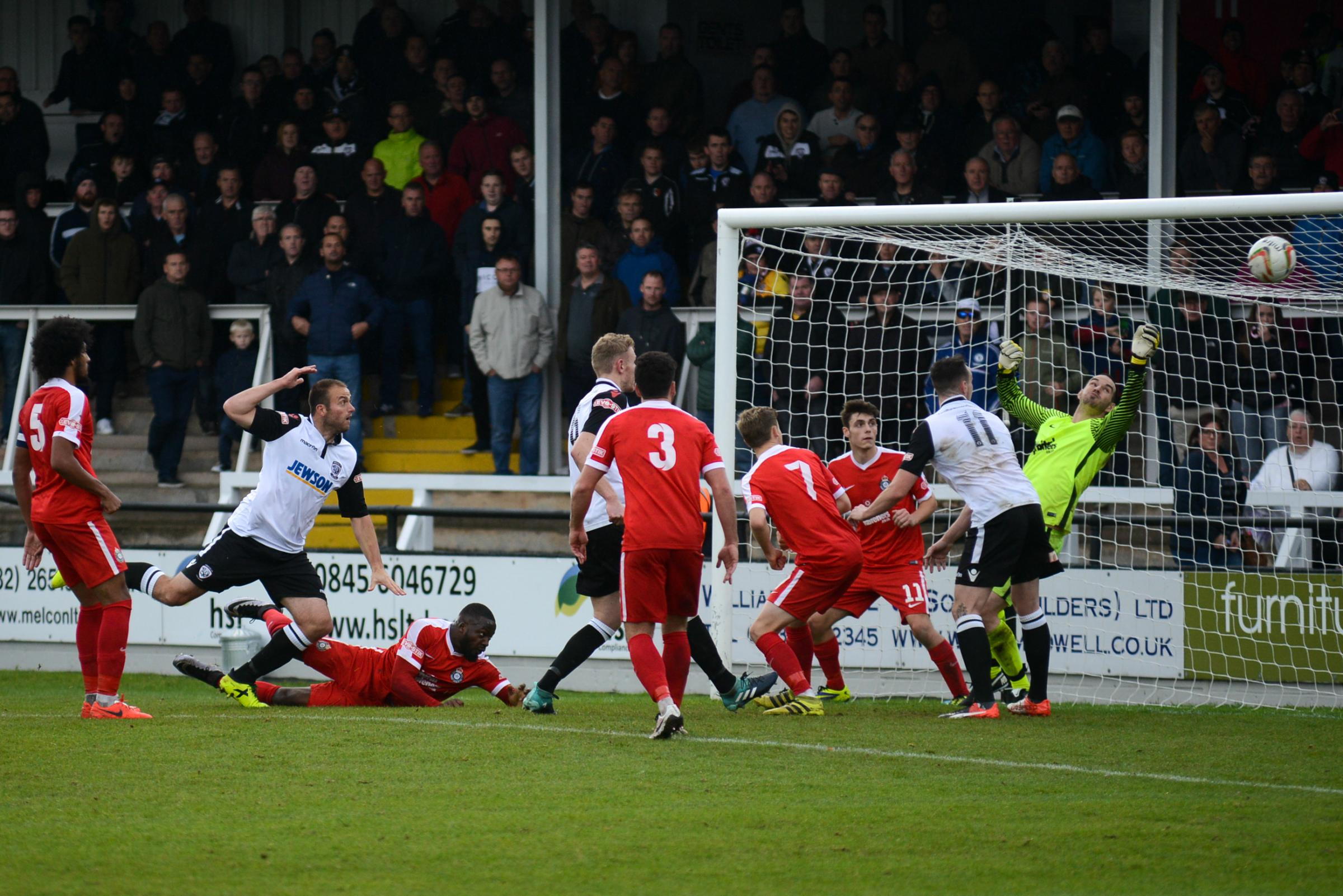 Mike Symons makes it 3-0 for Hereford against Kings Langley. Photo: James Maggs