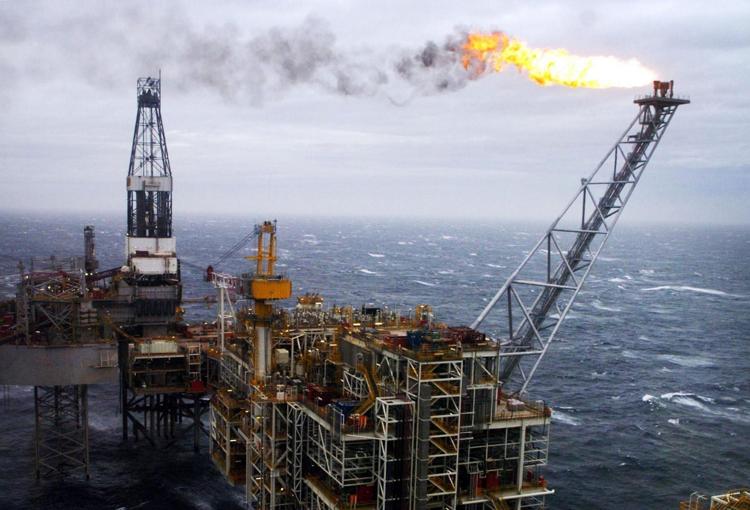 "File photo dated 16/03/07 of an oil rig in the North Sea, as experts warned that the UK's oil industry is ""close to collapse"" but the falling oil price could have a net benefit to the UK economy."