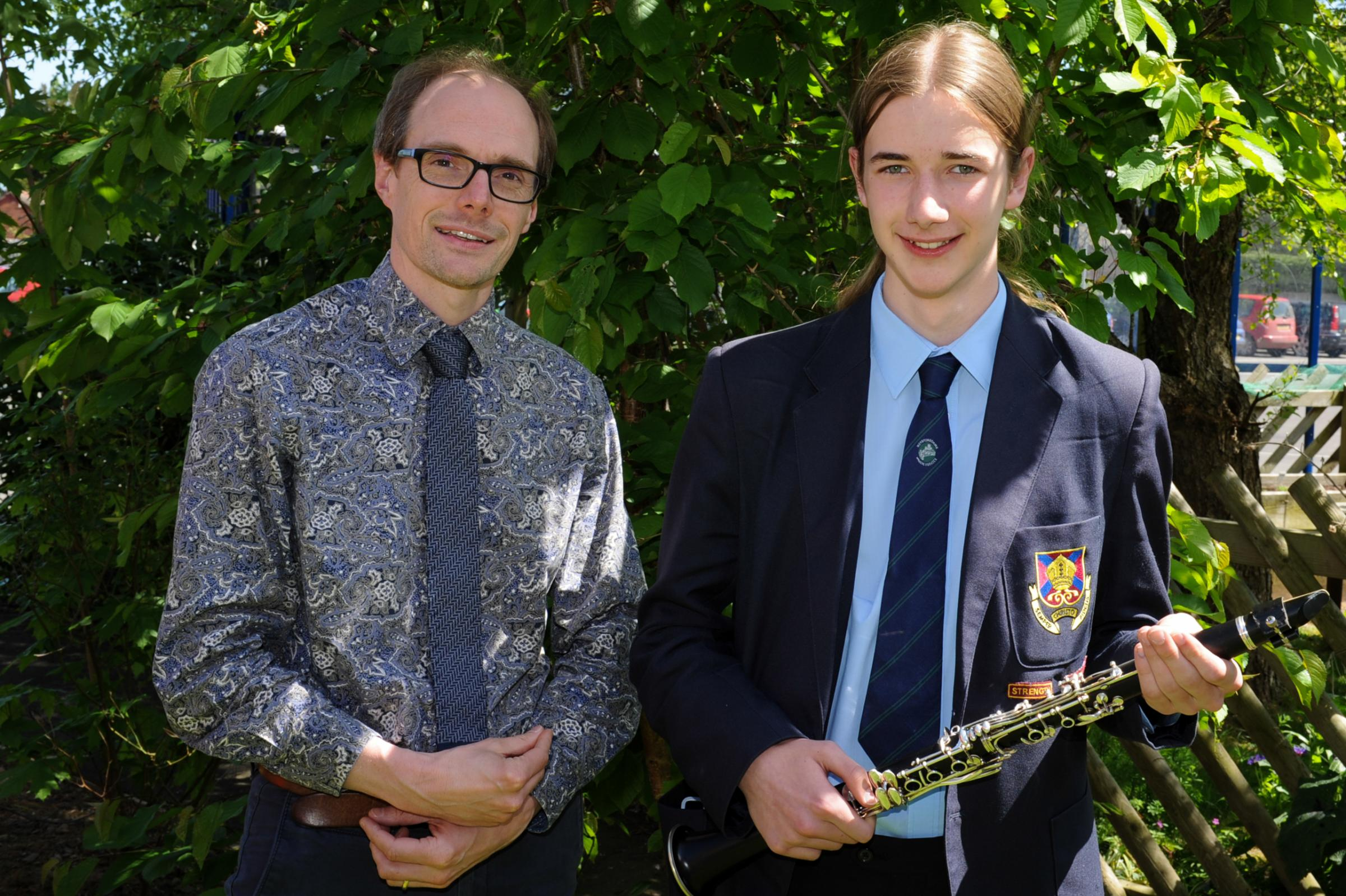 Bishop of Hereford's Bluecoat School pupil Eden Lloyd has been awarded a place with the National Youth Orchestra playing clarinet. Eden with Head of Music, Harry Sutton.