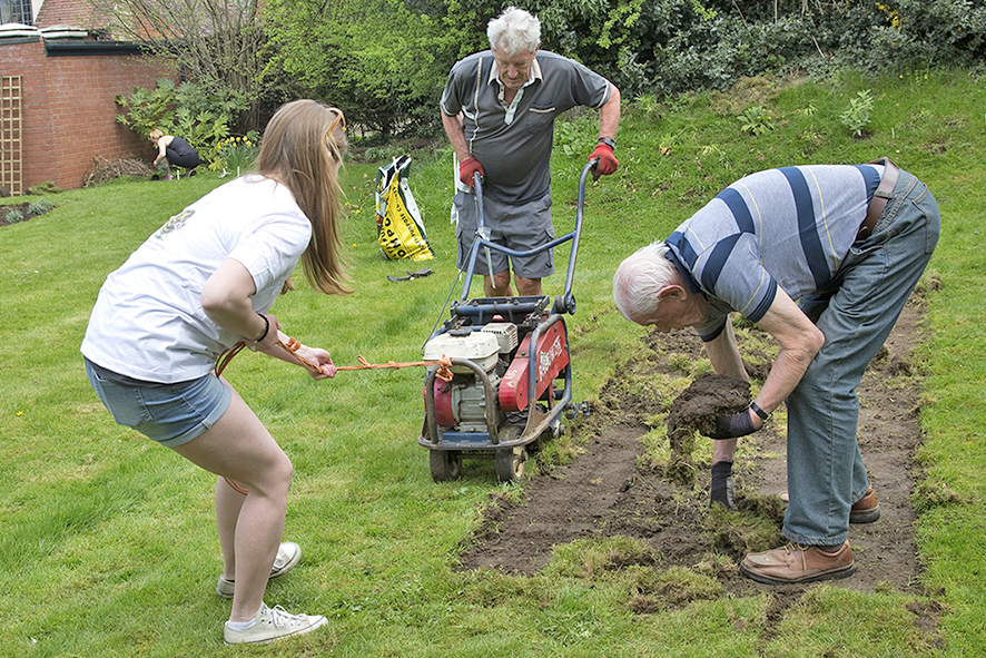 TURFING OUT THE OLD: Faith, aged 13, Barry Metcalfe and Stan Martin start turning the unused church lawn into a wildlife garden