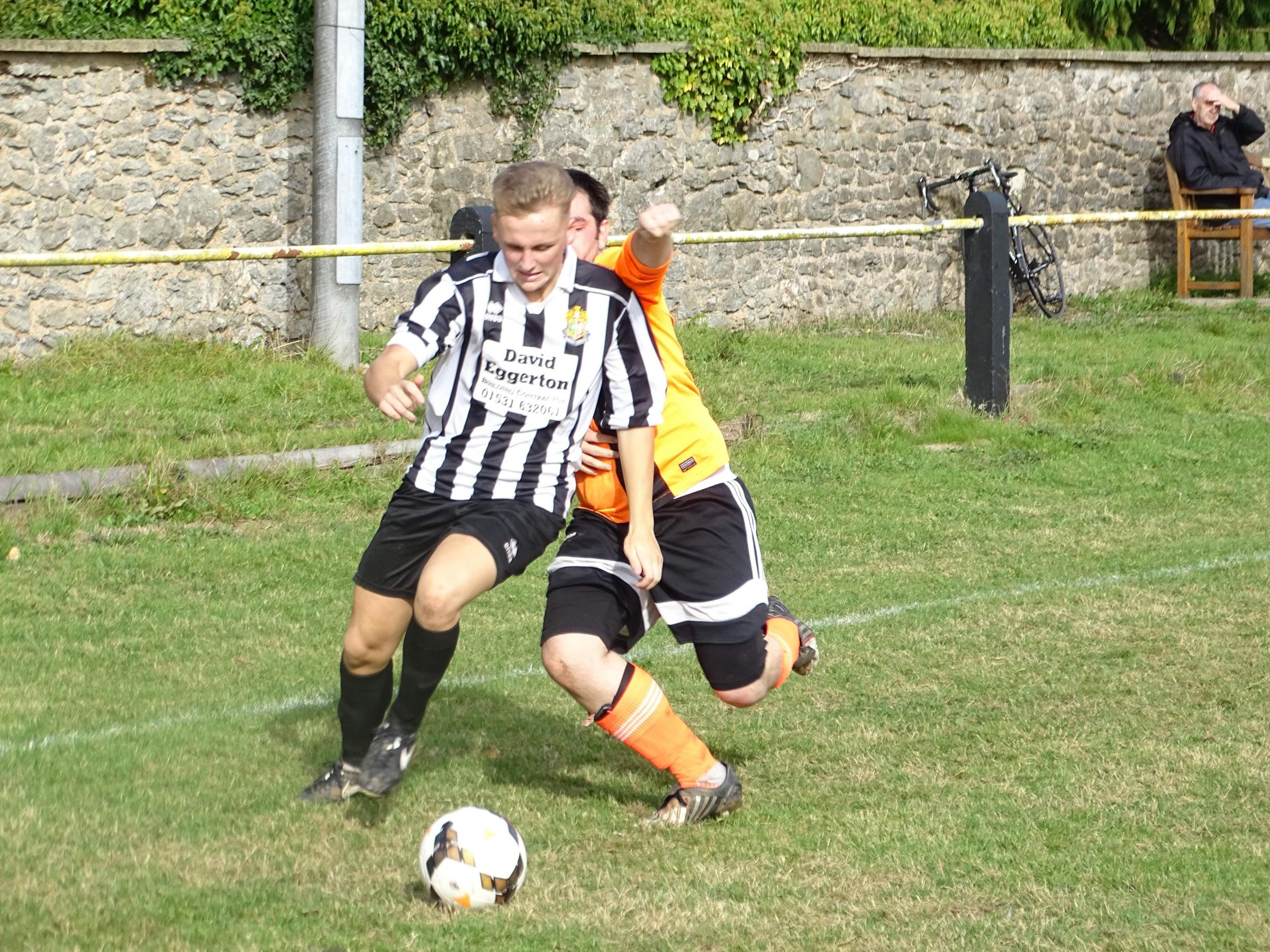 Action from Ledbury Town Reserves' epic encounter with Dore Valley at New Street. Picture: CHRIS PONTER