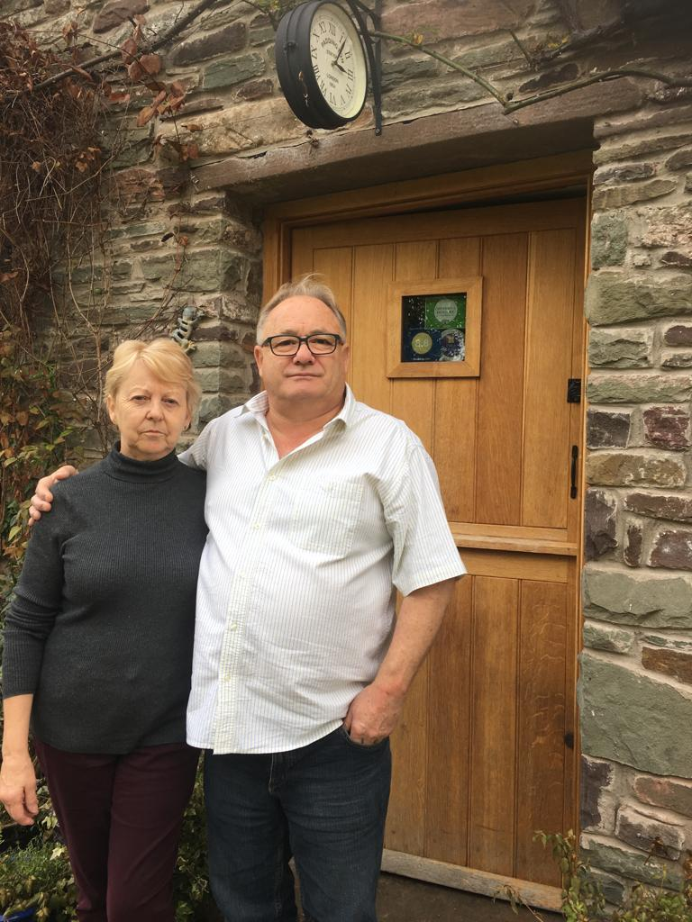 Wye Valley NHS Trust has apologised to Lynne Groves for her appointment cancellations. She is pictured next to her husband Stephen at their Talgarth home.