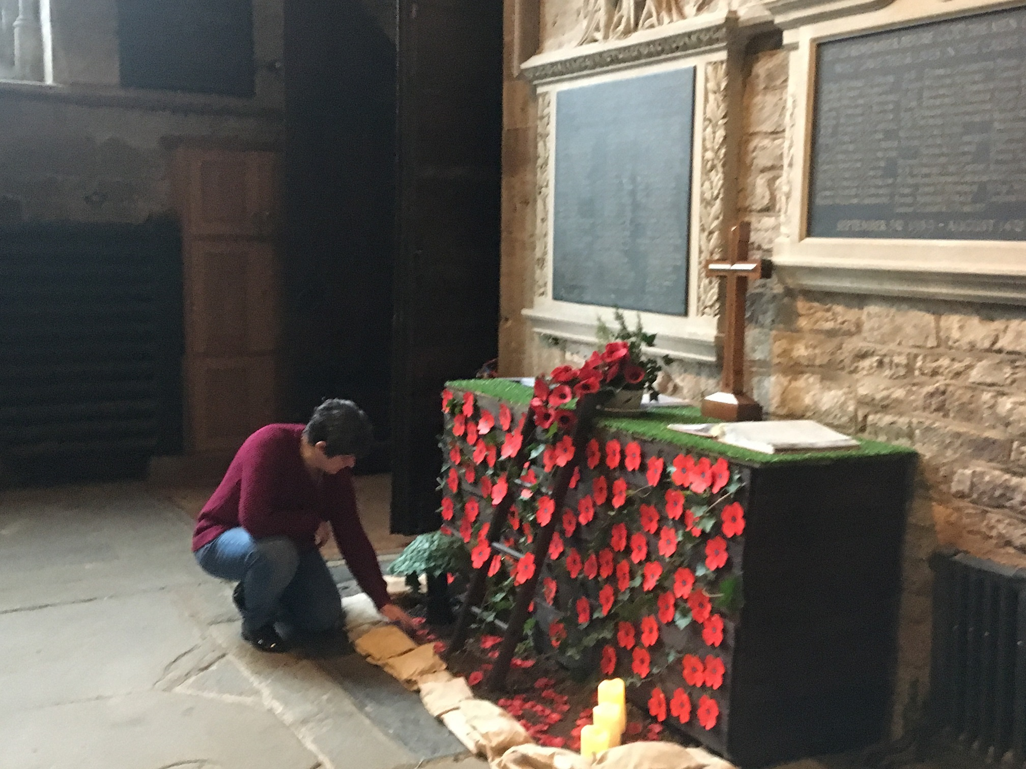 REMEMBERING: Local resident Brenda Hill sets up the trench memorial in the parish church