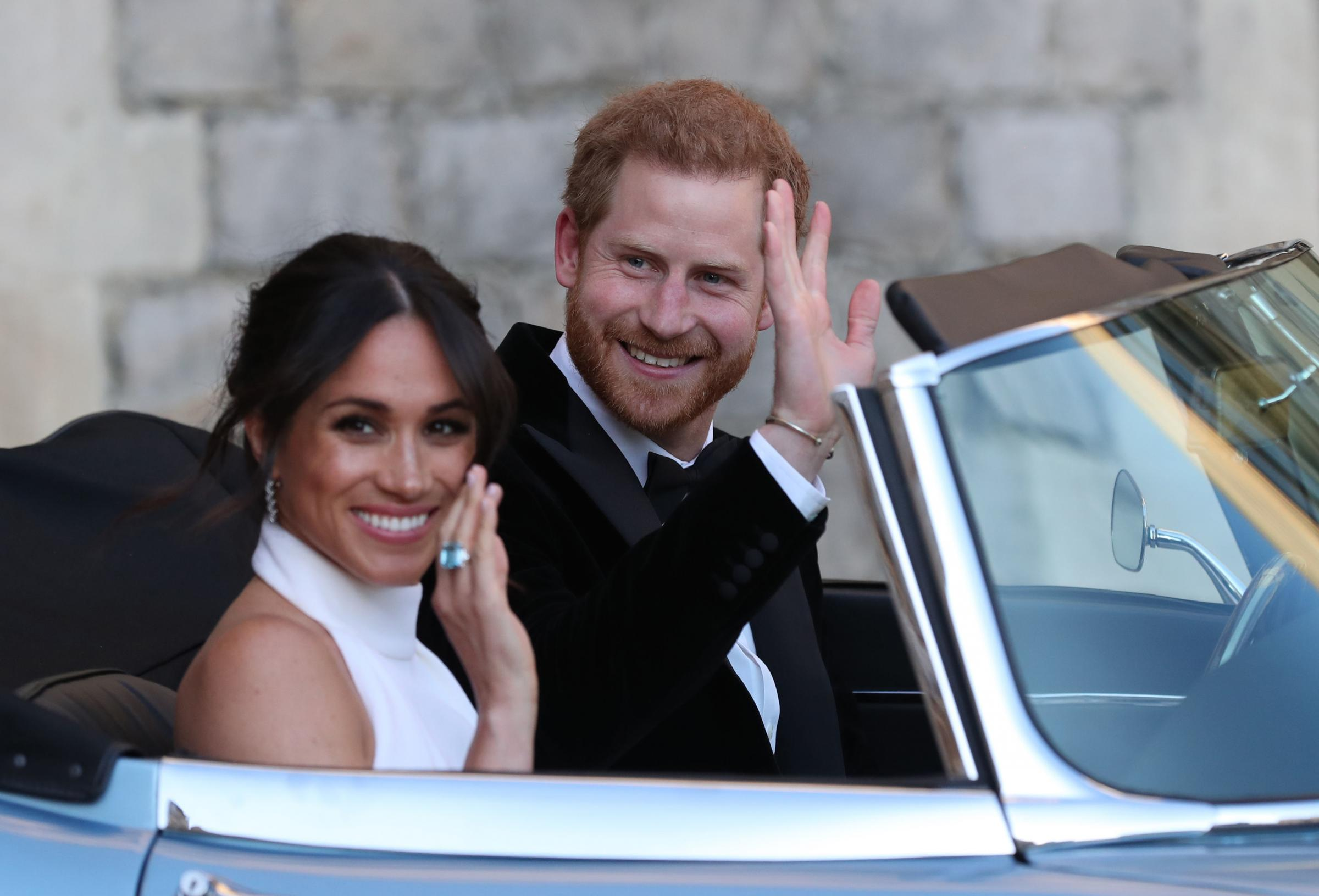 The newly married Duke and Duchess of Sussex, Meghan Markle and Prince Harry, leaving Windsor Castle after their wedding to attend an evening reception at Frogmore House, hosted by the Prince of Wales. PRESS ASSOCIATION Photo. Picture date: Saturday May 1